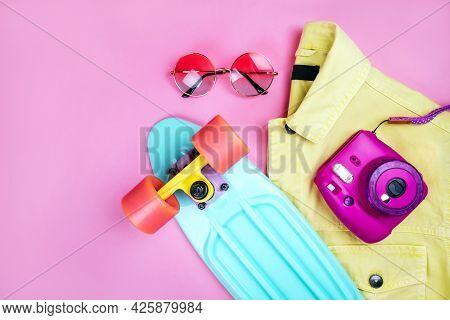 Summer Fashion Flatlay With Bright Yellow Denim Jacket, Turquoise Skateboard, Round Gradient Sunglas