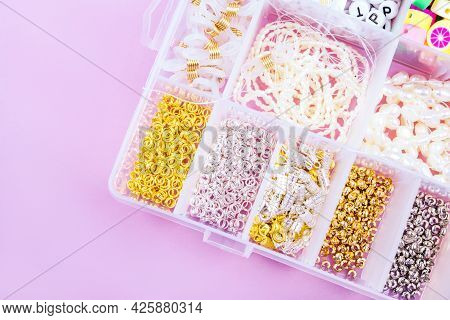 Creative Flatlay Of Different Pearl Beads With Tools For Making Jewelry, Wire String And Necklace Is