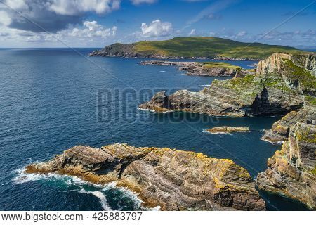Kerry Cliffs And Turquoise Water Of Atlantic Ocean Illuminated By Sunlight And View On Bray Head, Po