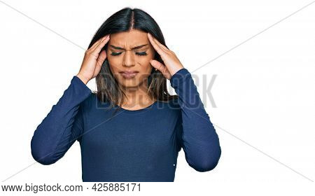 Young latin transsexual transgender woman wearing casual clothes suffering from headache desperate and stressed because pain and migraine. hands on head.