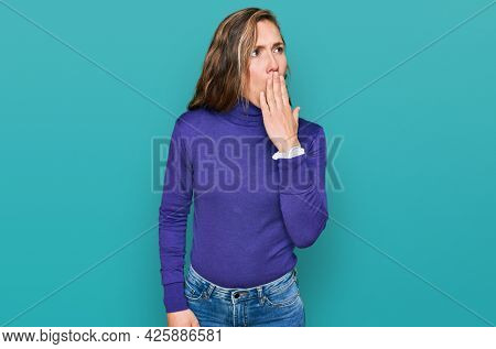 Young blonde woman wearing casual clothes bored yawning tired covering mouth with hand. restless and sleepiness.