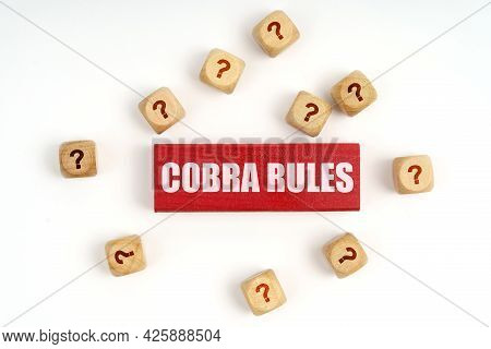 Question Concept. On The Table Are Cubes With Questions And A Red Plaque With The Inscription - Cobr