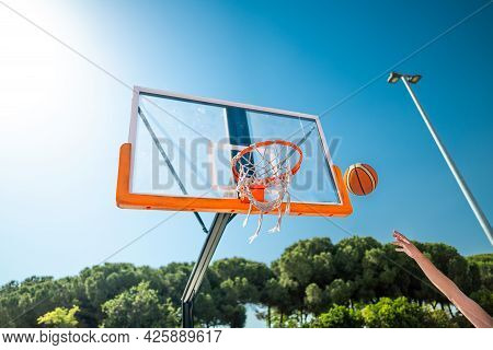 Hand Of Sportsman Playing Basketball Throwing The Ball At Playground, Doing Hook Shot Of Jump Shot,