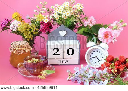 Calendar For July 20 : The Name Of The Month Of July In English, Cubes With The Number 20, A Cup Of