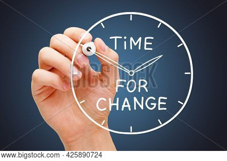 Hand Writing Time For Change On A Drawn Clock With White Marker On Transparent Wipe Board. Concept A