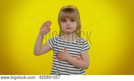 I Swear To Be Honest. Sincere Responsible Cute Kid Child 5-6 Years Old Raising Hand To Take Oath, Pr