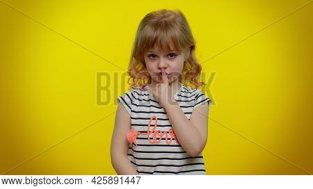 I Will Not Say Anyone. Funny Little Blonde Teen Kid Child Girl Closing Her Mouth With Hand, Looking