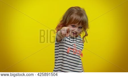 You And Me Here And Right Now. We Are Team. Little Child Girl Looking Authoritative, Fingers Down, D