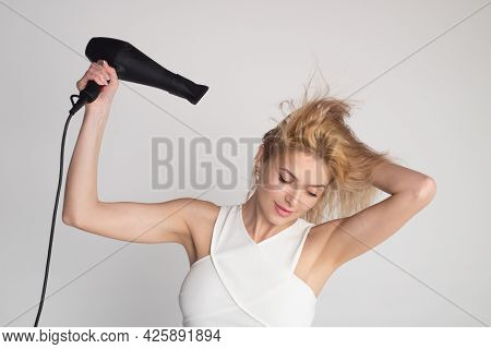 Young Girl With Drying Hair With Hair Dry. Woman Blow Drying Her Hair.