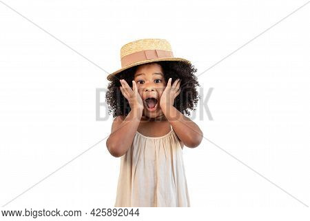 Portrait Of A Cheerful And Cute African American Girl. Child Was Surprised And Shocked When She Saw