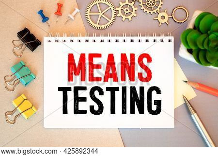 Means Testing, Text On White Notepad Paper On Gray Background.