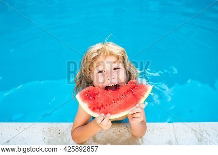 Child With Watermelon In Pool Outdoor. Kid Having Fun In Swimming Pool. Kids Summer Vacation And Hea