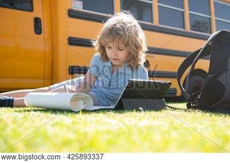 Kid Study Online With Tablet In Park. Social Distance During Quarantine, On-line Education Concept,