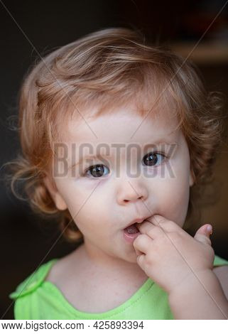 Portrait Of A Cute Child Baby. Close Up Caucasian Kids Face. Closeup Head Of Funny Kid.