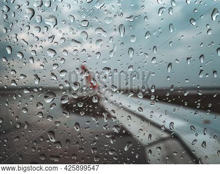 Rain Drop At Airplane Window Before Take Off When Monsoon Season.