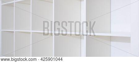 Blank white bookshelf, empty shelves