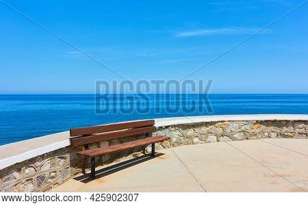 Bench on promenade along the sea in Rethimno, Crete Island, Greece. Landscape