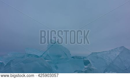 Turquoise Ice Floes And Hummocks Against The Foggy Sky. Bizarre Shapes, Sharp Edges. Close-up. Copy