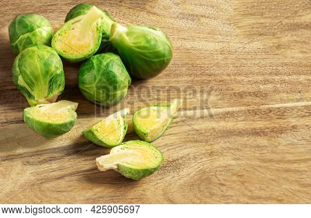 Brussel Sprouts On A Cutting Board.  Cooking Brussels Sprouts,  Top View. Copyspace