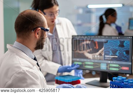 Medical Scientist Conducting Vaccine Research Against New Virus In Modern Equipped Laboratory. Chemi