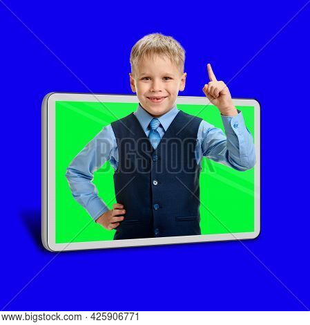 Smart Young Boy Using New Technology At School For Online Study Concept, Blue Chroma Key On The Back