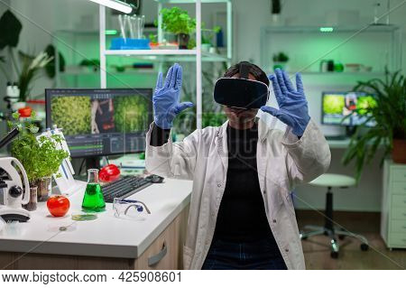 African Scientist Biologist Conducting Research Using Virtual Reality Doing Hand Gesture For Agronom