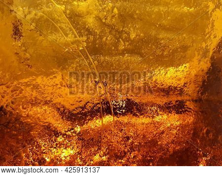 Thick Glass Of Beautiful Amber-orange Color Close-up