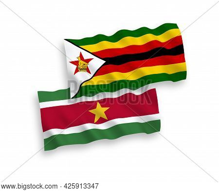 National Fabric Wave Flags Of Republic Of Suriname And Zimbabwe Isolated On White Background. 1 To 2
