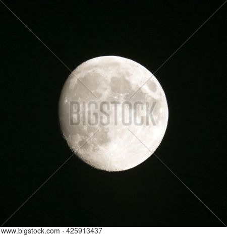 Almost Full Moon In The Black Night Sky