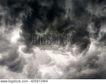 A Black Thundercloud Covered The Sky On A Sunny Day, A Thunderstorm Is About To Begin