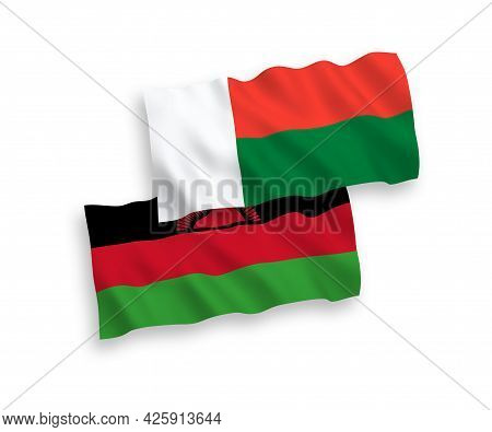 National Fabric Wave Flags Of Malawi And Madagascar Isolated On White Background. 1 To 2 Proportion.