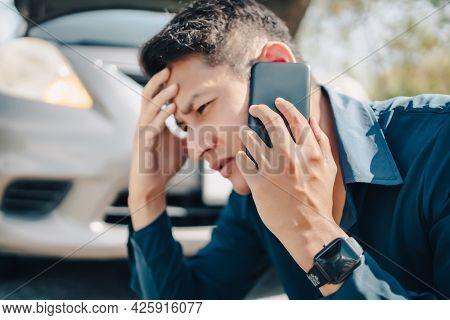 Young Man Calling,  Texting For Car Service On Roadside Assistance After Broken Car. Car Broken, Car