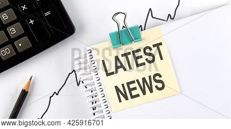 Stickers With Pencils And Notebook With Text Latest News On The Chart Background