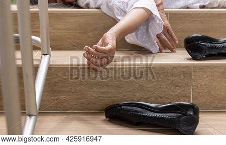 Elderly Woman With Walker Falling Down Stair