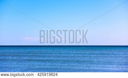 Clear sea horizon and blue sky,  may be used as background