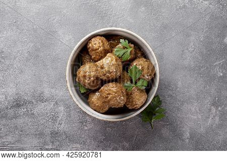 Traditional Swedish Meatballs In A Bowl On Gray Background Top View