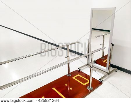 Rehab Parallel Bars With Mirror In White Room At Rehabilitation Center
