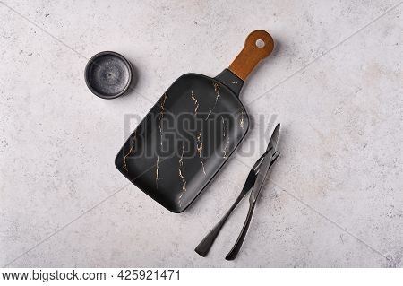 Empty Set Of Cutting Board Tray, Knife, Fork, Saucer On Light Table. Concept For Cheese And Meat Sli