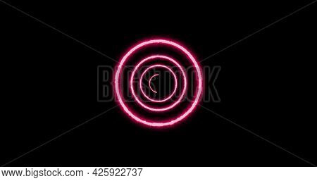Image of multiple colourful green, purple, pink and blue neon circles moving on black background. Colour light movement concept digitally generated image.