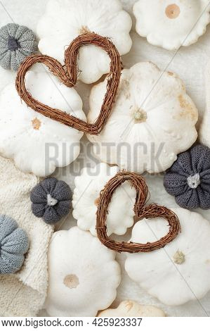 Creative Autumnal Card - White Sweater, Pumpkin And Hearts Wreath On White Background Copy Space, Mi