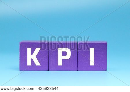 Purple Cubes With Kpi Letters And A Light Blue Background