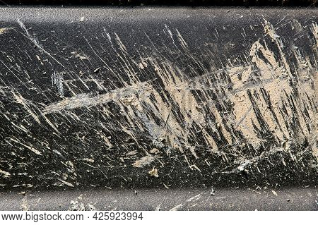 Texture Of The Surface Of A Dirty Car Splashed With A Swamp Dried To Matte Black Paint Close-up.