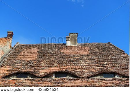 Architectural details in Sibiu - the so-called home with eyes, rooflights on roof