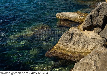 Rocky Coast Of The South Of The Island Of Mallorca At Sunrise With The Mediterranean Sea In The Back