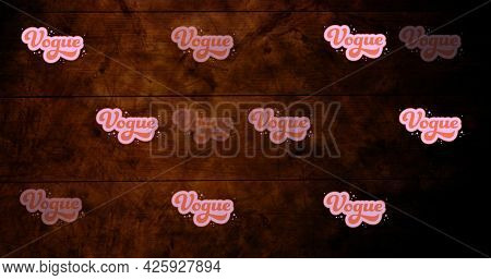 Composition of vogue texts repeated on wooden background. fashion and beauty accessories background pattern concept digital image.