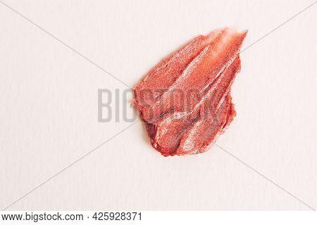 A Smear Of Nude Lipstick On A Light Background