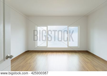 Empty White Room With Light From Window