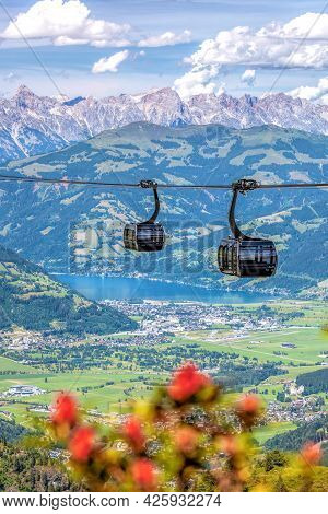 Panoramatic Modern Cable Cars Against Town Of Zell Am See  In The Zell Am See-kaprun Region, Kitzste