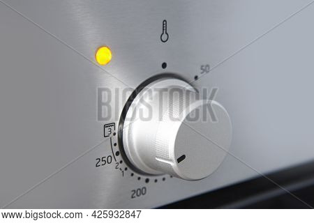 Oven Cooking Temperature Control Knob. Kitchen Equipment Panel Detail. Stove