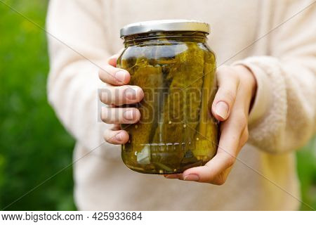 Woman Housewife Hand Holding Glass Jar Of Pickled Cucumbers. Domestic Preparation Pickling And Canni